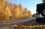Jeep parked along the Natchez Trace, surrounded by fallen leaves.
